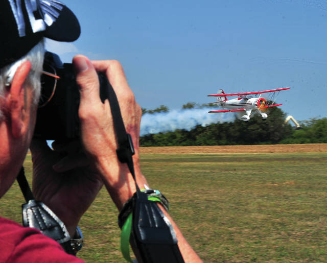 Richard Coffield of Versailles trains his camera on a low-flying WACO aircraft on Saturday during the annual WACO Fly-In event.
