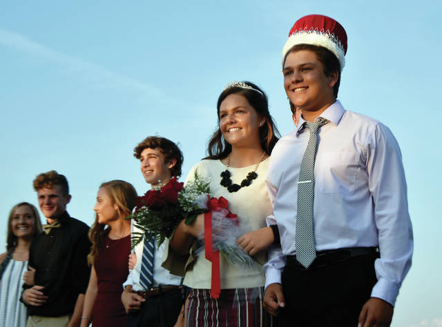 Newton seniors Brooke Deeter, second from right, and Kleyson Wehrley, far right, were crowned queen and king during the Newton High School Homecoming soccer game at the high school on Friday evening. ©2019 Miami Valley Today. All rights reserved.