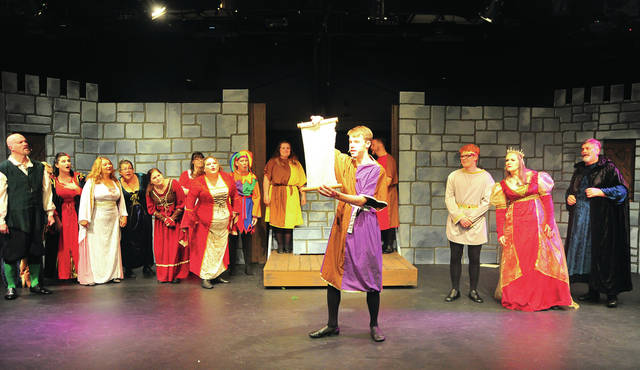 "Roman Bianco, who plays Sir Harry, center, performs a scene from ""Once Upon a Mattress,"" at the Troy Civic Theatre Barn in the Park on Tuesday."