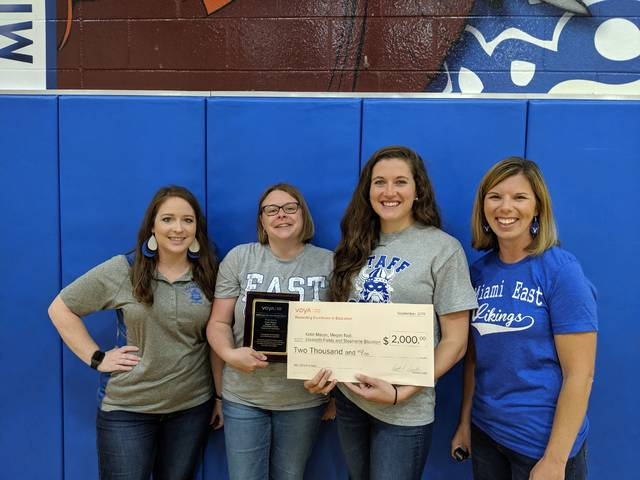"""From left, Miami East Elementary School teachers Stephanie Blackton, Elizabeth Fields, Katie Mason and Megan Noll recently were awarded Voya Financials' """"Unsung Heroes"""" grant for $2,000 for their """"Viking Book Room"""" project."""