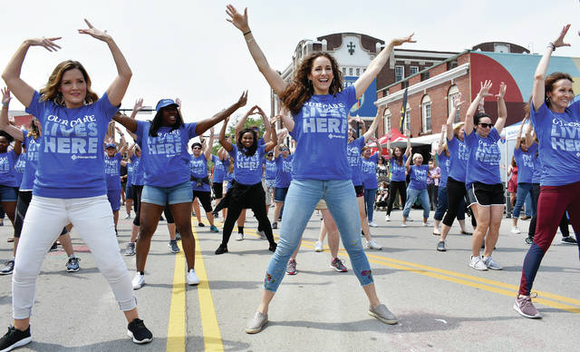 A Premier Health flash mob fills the streets of downtown Troy during June's Troy Strawberry Festival.
