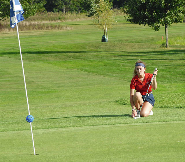 Rob Kiser|Miami Valley Today Piqua's Adde Honeycutt looks over a putt from the fringe on the eighth hole Wednesday. Honeycutt would hole the putt.