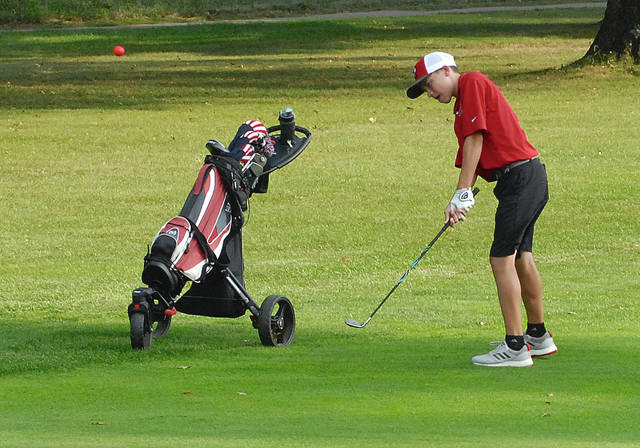 Rob Kiser|Miami Valley Today Newton's Chandler Peters chips on to the 12th green Wednesday.