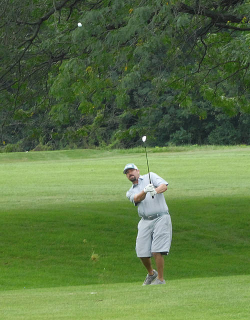 Rob Kiser|Miami Valley Today Matt Maurer hits his approach on the 17th hole at Miami Shores Saturday.