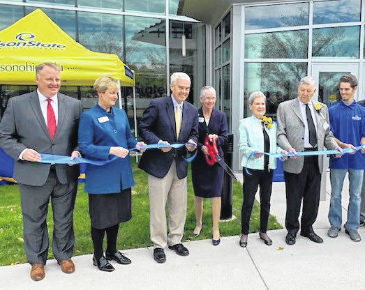 Edison State Community College President Dr. Doreen Larson, center, leads the ceremonial ribbon cutting for the college's new Robinson Student Career Center Wednesday afternoon, along with, from left to right, Jack Hershey, president and CEO of the Ohio Association of Community Colleges; Tami Baird Ganley, chair for the Edison State Community College Board of Trustees; Pat and Thom Robinson; and Dylan Warren, Edison State Student Senate Director of Administration.