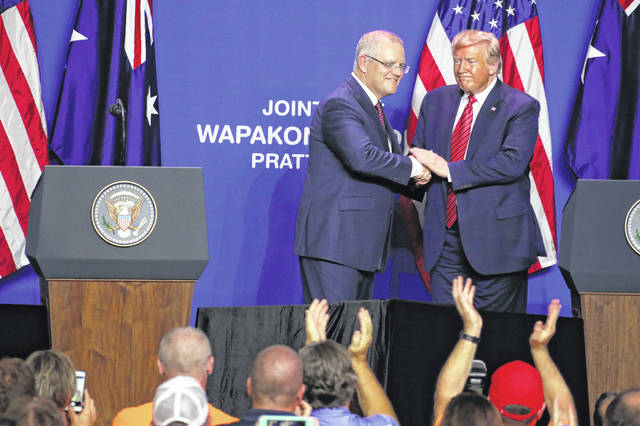 Australian Prime Minister Scott Morrison and President Donald Trump shake hands after giving speeches together at Pratt Industries in Wapakoneta on Sunday evening.