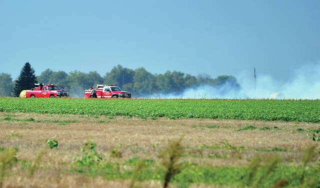 "Firefighters from Piqua, Covington, and Troy battle a field fire in the 3000 block of Washington-Concord Road on Wednesday afternoon. The fire, which was described as ""about half a football field in size"" spread quickly in the corn stubble field due to winds. There were no injuries reported and no damage to equipment. The call, which came in around 3:30 p.m., was minutes after Troy Fire Department responded to a structure fire on Gearhart Lane. That fire began in an attached garage and spread to the home. Firefighters quickly knocked it down and kept damage to a minimum. There were no reported injuries."
