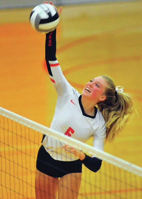 Tippecanoe's Molly Achterberg hits the ball against Troy Wednesday night.