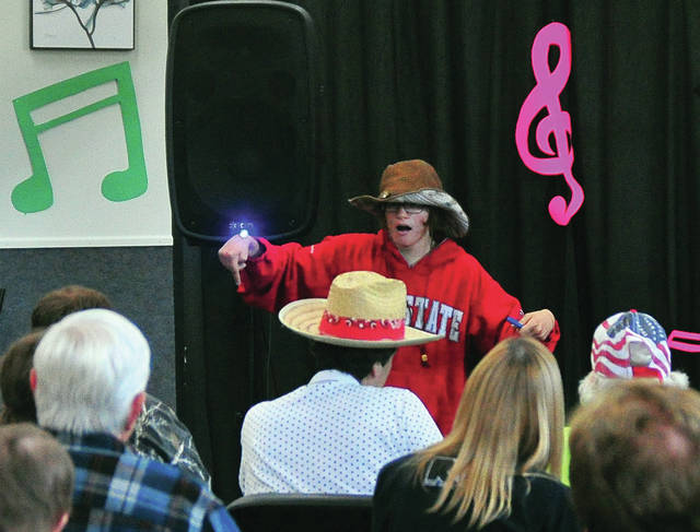 "Elizabeth Bruns, a Troy resident, showcases her talent to ""When the Sun Goes Down"" during a talent show at RT Industries, which helps to promote the welfare and needs of adults with disabilities, on Friday morning. ©2019 Miami Valley Sunday News, all rights reserved."