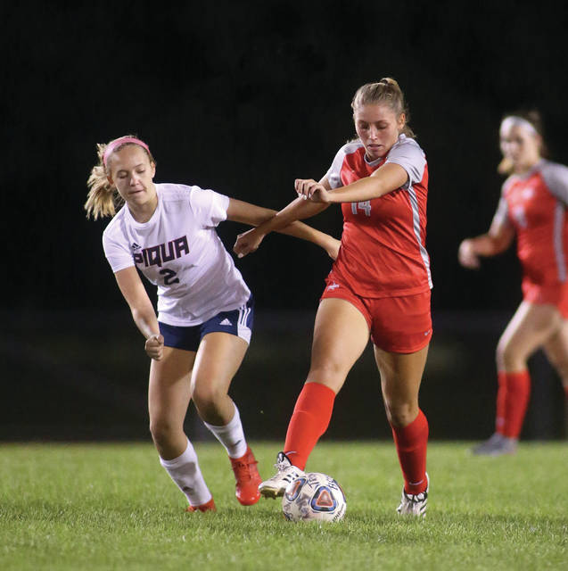 Lee Woolery|Miami Valley Today Troy's Abby Westfall brings the ball up the field as Piqua's Audrey Evans defends Wednesday at Troy Memorial Stadium.