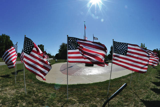 A semi-circle of U.S. Flags has been added to the Piqua Veterans Memorial near Forest Hill Cemetery. Superintendent Jim Roth said that the new flags will fly regularly around the memorial.