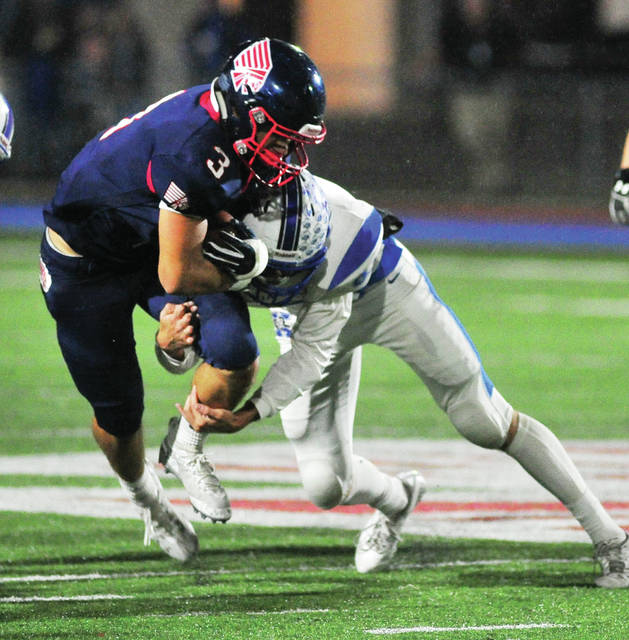Piqua's Jasiah Medley grinds out some extra yards against Xenia Friday night at Alexander Stadium/Purk Field.