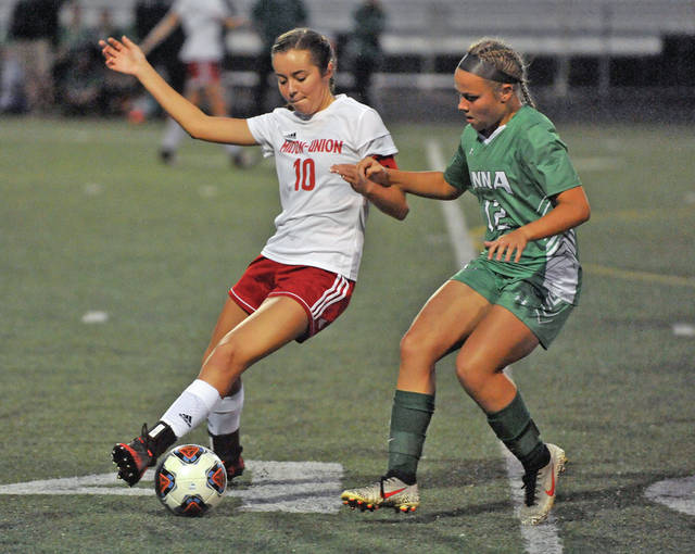 Josh Brown|Miami Valley Today Milton-Union's Rachel Thompson battles Anna's Michaela Ambos for the ball during a Division II tournament game Monday at Northmont High School.