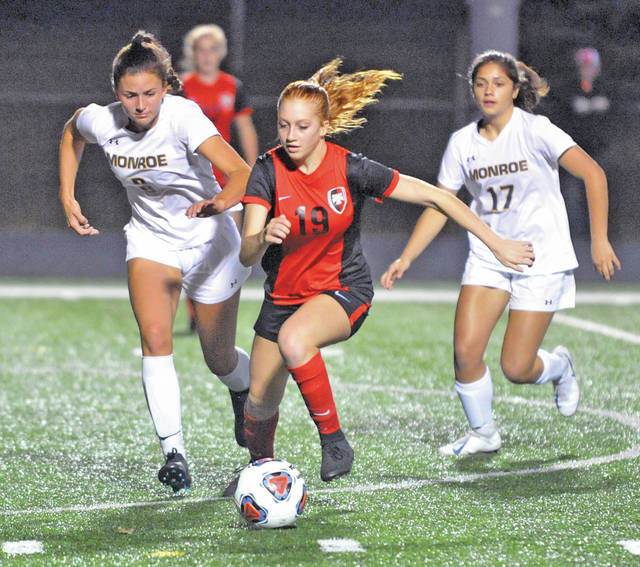 Josh Brown | Miami Valley Today Tippecanoe's Emma Patzek races past a pair of Monroe defenders during Tuesday's Division II regional semifinal in Lebanon.