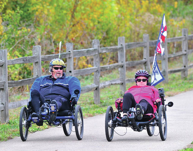 Greg and Cindy Guldon of Tipp City take in the fall colors along the bike path north of Troy on Tuesday afternoon.