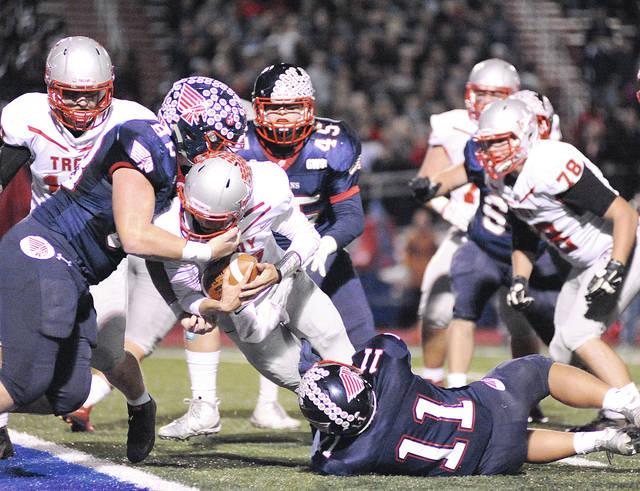 Anthony Weber|Miami Valley Today file Troy's Hayden Kotwica (12) fights his way in for a touchdown against Piqua during the 2016 matchup.