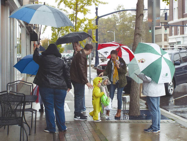 Matt Clevenger | For Miami Valley Today Trick-or-treat participants braved the cold and rain Saturday to be a part of Troy's annual Hometown Halloween.