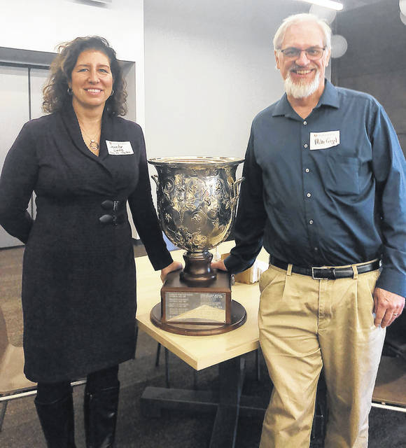 Provided photo Troy High School Latin teachers Jennifer Limke, left, and Mike Gegel pose with the Hildesheim Vase Award, which Troy won this year as Ohio's top high school Latin program.