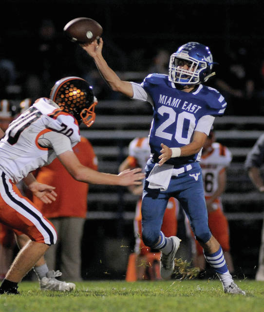 Miami East quarterback Tyler Kirby throws a pass Friday against Ansonia.