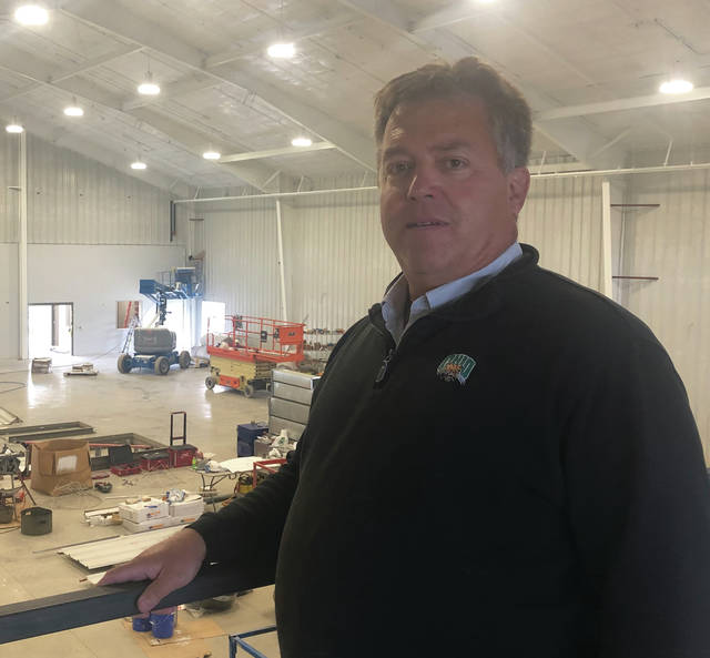 Newton Local School Superintendent Pat McBride stands along the rail of the mezzanine area at the school's new 17,000-square-foot Fieldhouse on Oct. 4. The $2.5 million facility will be completed by mid-December. The district is paying for the facility with open enrollment funds.