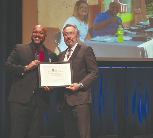 Provided photo Main Street Volunteer of the Year DeWayne Williams receives his award at the Heritage Ohio Annual Preservation and Revitalization Conference in Newark on Oct. 22.