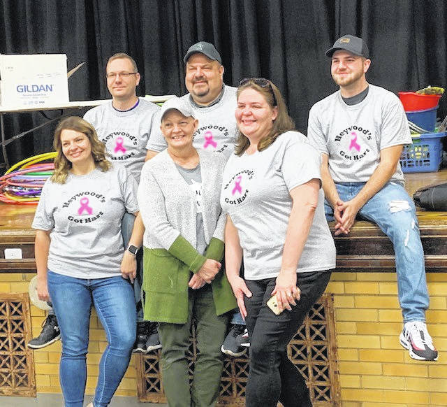 Heywood Elementary administrative assistant Beth Hart, center, poses with family members, from left to right, daughter Emily, son Logan, husband Mike, daughter Regina, and Emily's boyfriend Josh Luthman.