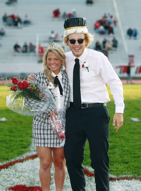 "Lee Woolery | Miami Valley Today Troy High School named its Homecoming king and queen on Friday night at the football game against Stebbins. Ella Furlong was named queen, while Logan C. Rolon-Pawlaczyk was crowned king. The homecoming dance will take place from 8-11 p.m. Saturday, Oct. 5 in the Troy High School Fletcher (auxiliary) Gym. The theme of this year's dance is ""Roaring '20s."""