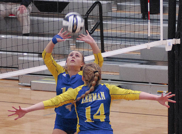 Rob Kiser|Miami Valley Today Lehman Catholic's Megan Carlisle sets the ball as Abby Schutt moves into position.