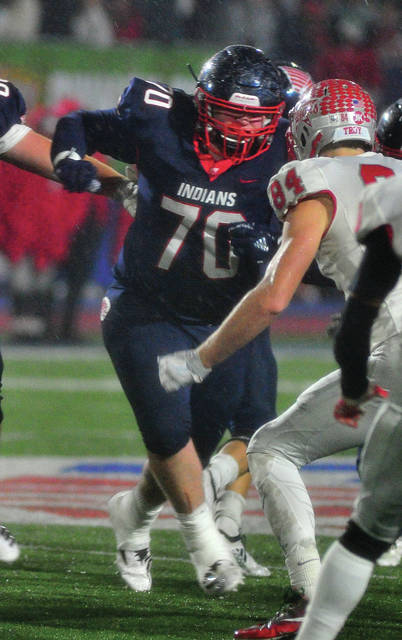 Mike Uller|MVT File Photo Piqua offensive lineman Riley Hunt blocks in last year's game with Troy.