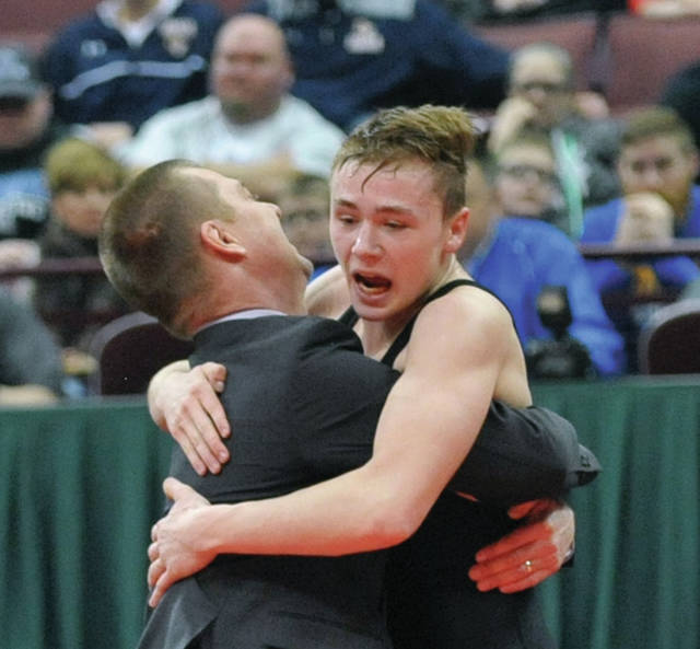 Josh Brown | Miami Valley Today file Troy Christian's Ethan Turner hugs his father, assistant coach Wes Turner, after he won the 113-pound state championship match over Genoa Area's Oscar Sanchez at the 2018 Division III state tournament at the Schottenstein Center.