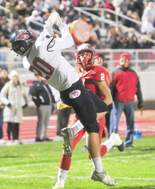 Piqua receiver Dylan Chaney makes a a leaping catch for a touchdown Friday night against Troy.