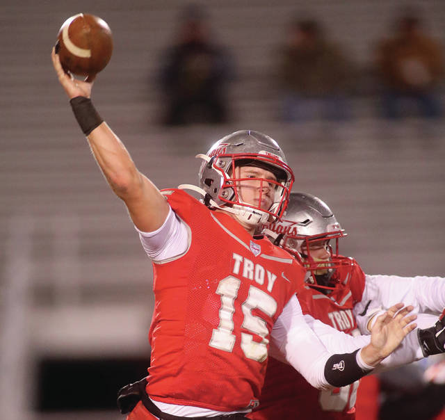 Lee Woolery | Miami Valley Today Troy quarterback Brayden Siler throws a pass against Olentangy in a Division II playoff game Friday at Troy Memorial Stadium.