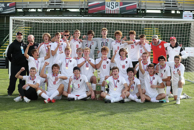 Lee Woolery | Miami Valley Today The Division II state champion Tippecanoe boys soccer team poses with the trophy after defeating Warren Howland Sunday at Columbus' MAPFRE Stadium.
