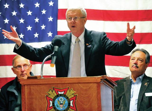 Troy Mayor Mike Beamish delivers the Veterans Day address in Troy on Monday. The annual event was moved to Troy VFW Post 5436 on LeFevre Road due to the threat of inclement weather.