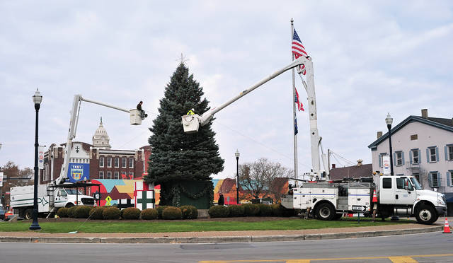 City workers string lights on Troy's Christmas Tree on Wednesday morning as preparations for next Friday's annual Grand Illumination event kick in to high gear.