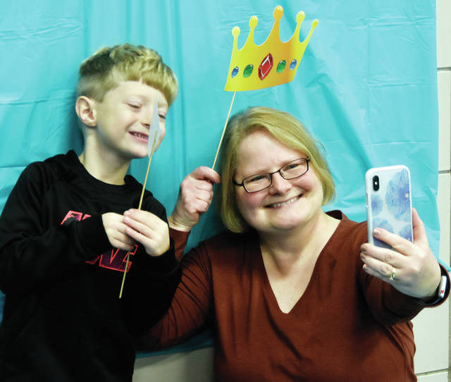 Kindergartner Zander Miller poses for a fun selfie with his grandma Robin Bomblin during Grandparents Day at Cookson Elementary School on Thursday.
