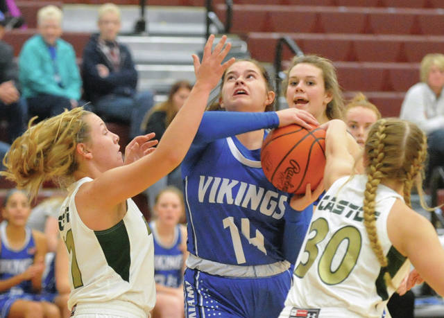 Josh Brown | Miami Valley Today Miami East's Camryn Miller goes for a layup in traffic against Springfield Catholic Central Friday at Urbana High School.