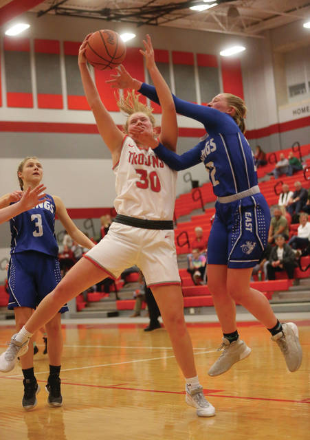 Lee Woolery | Miami Valley Today Miami East's Cadence Gross and Troy's Brynn Siler battle for a rebound Wednesday at the Trojan Activities Center.