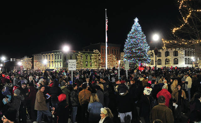 Thousands of people filled the public square in Troy on Friday to watch the Grand Illumination event and arrival of Santa.