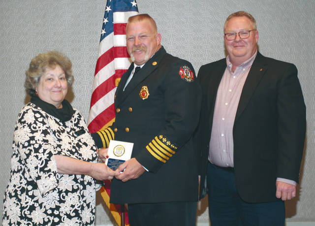 Provided photo Troy Fire Department Assistant Chief Eric Krites, center, was awarded Firefighter of the Year by the Ohio State Grange. He received his award from Ohio State Grange Master Sue Roy, left, and Ohio State Grange Community Service Chairman Kevin Evan, right.