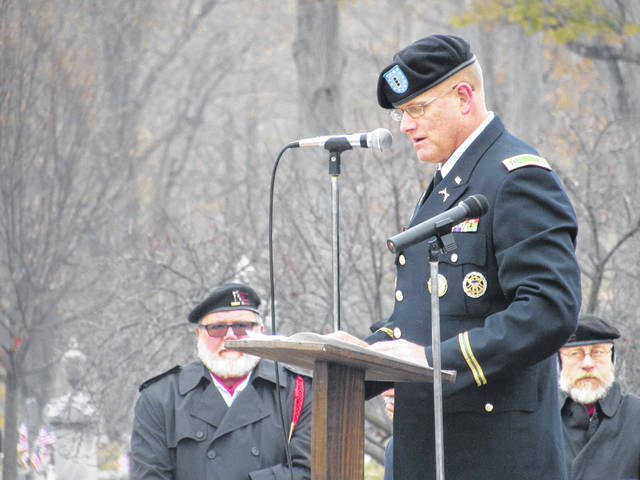 Sam Wildow | Miami Valley Today Chief Warrant Officer Paul Reece of the U.S. Army Reserves addresses the crowd at the 2019 Veterans Day Ceremony, hosted by the Piqua Veterans Association at the Veterans Memorial on Monday.