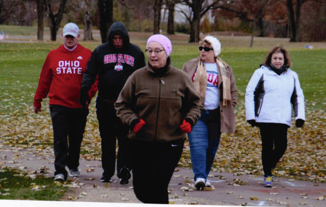 Photo Provided by Jody Toopes A group of runners heads down at cart path on the back nine at Echo Hills during the annual 5k walk/run to honor veterans.