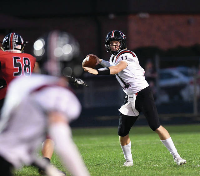 Ben Robinson | GoBuccs.com file Covington quarterback Cade Schmelzer throws a pass earlier this season against Fort Loramie.
