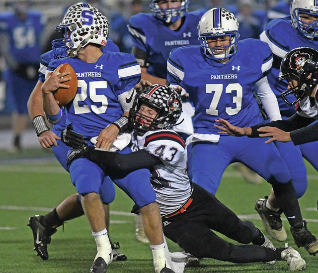 Ben Robinson | GoBuccs.com Covington's Gavin Swank brings down Chillicothe Southeastern quarterback Lane Ruby during Friday night's Division VI regional semifinal game at Xenia's Doug Adams Stadium.