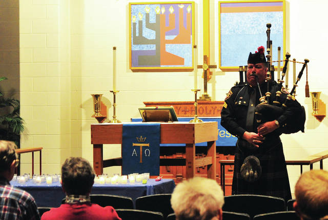 """Piper Del Braund performs """"Amazing Grace"""" during Monday's memorial service for victims of violent crimes in Miami County. The service, sponsored by Miami County Victim Witness, was held at the First Lutheran Church in Troy."""
