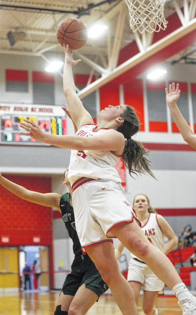 Lee Woolery | Miami Valley Today Troy's Macie Taylor hits a reverse layup under the basket against Greenville Wednesday at the Trojan Activities Center.