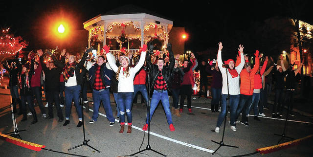 """Piqua High School's Show Choir, """"The Company,"""" entertains a large crowd during Friday's Christmas on the Green event in downtown Piqua."""