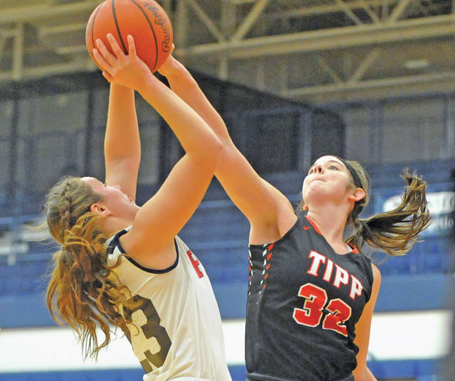 Josh Brown | Miami Valley Today Tippecanoe's Katie Hemmelgarn blocks a shot by Piqua's Kenzi Anderson at the end of the first half Wednesday at Piqua High School.