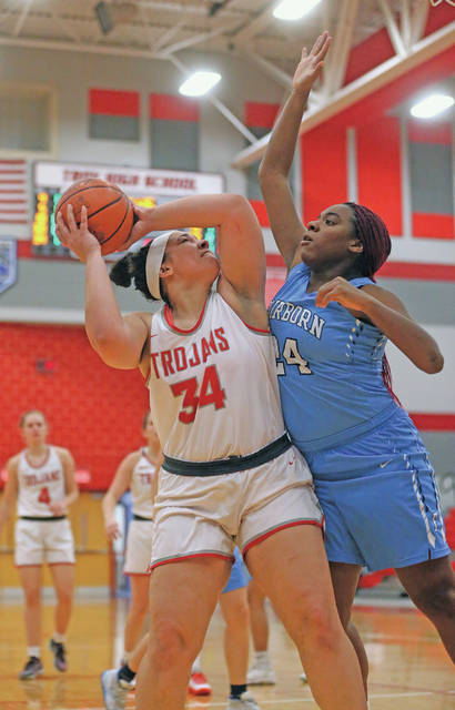 Lee Woolery | Miami Valley Today Troy's Tia Bass scores in the paint as Fairborn's Jasmine McMoore defends Monday at the Trojan Activities Center.