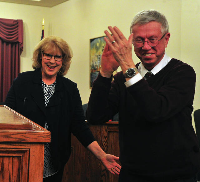 Newly-retired former mayor Mike Beamish applauds as Mayor Robin Oda officially takes the reins as mayor of the city of Troy, during ceremonies at the Troy Municipal Building on Friday.